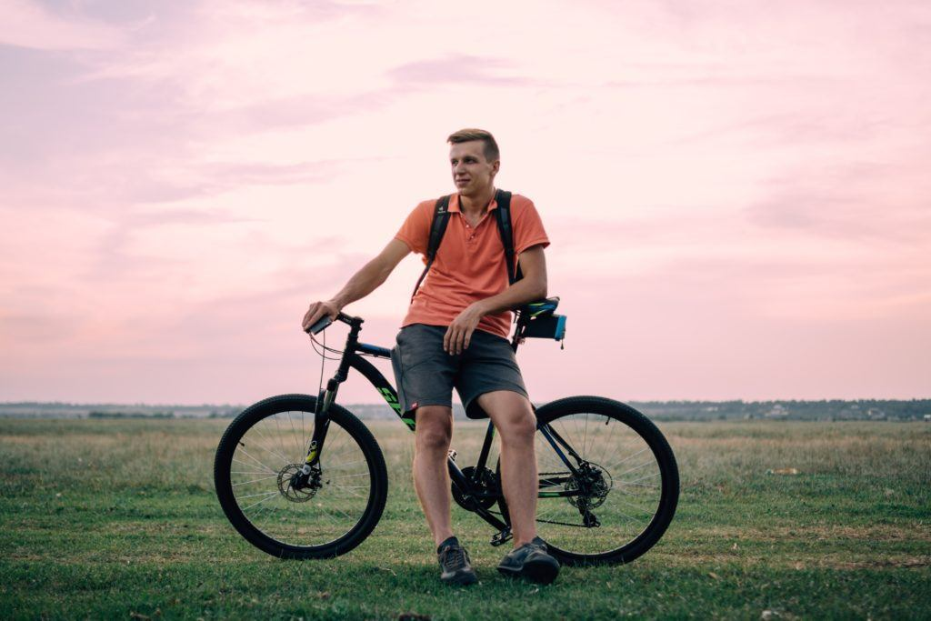 A man riding on the back of a bicycle