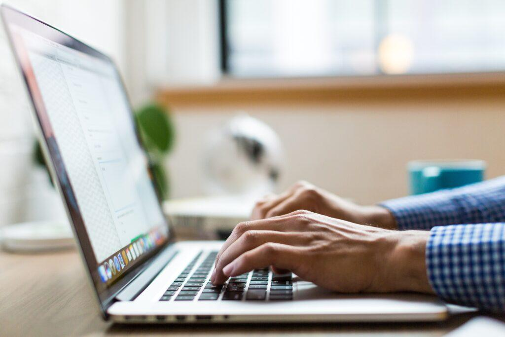 Person typing on a computer